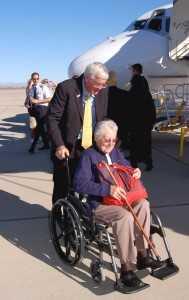Mayor Hawker assists a passenger into the Phoenix-Mesa Gateway Airport terminal after her arrival from Cedar Rapids.