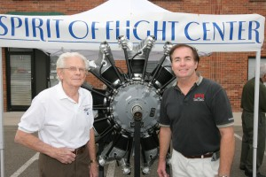 "WWII P-51 pilot James S. ""Pete"" Peterson (left) and Gordon R. Page stand in front of the Spirit of Flight Center's restored Wright Cyclone R-1820 engine."