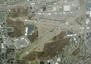 The small gray patch on the end of Runway 24, towards the right in the middle of the photo, is the EMAS installed since a 2005 accident. Runway 1, on the lower left, is about to have one installed, since two local roads come together at right angles.