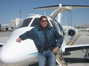 John Travolta takes in the sights at the Reno National Championship Air Races and Air Show 2007 in front of his new Eclipse 500.
