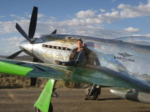Breitling spokesman John Travolta relaxes on the wing of Precious Metal, a P-51D Mustang piloted by Ron Buccarelli during the 2007 Reno Air Races and Air Show.