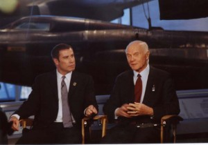 On Dec. 17, 2002, Senator John Glenn (right) joined with actor and aviator John Travolta, master of ceremonies, to kick off a yearlong commemoration honoring the 100th anniversary of the Wright brothers' first powered flight.