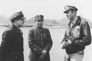 Col. Tex Hill (right) converses with General Chow Chi-Rao, titular chief of the Chinese Air Force, and a Chinese-American Composite Wing commander during an inspection of the CACW at Kweilin, in 1944.