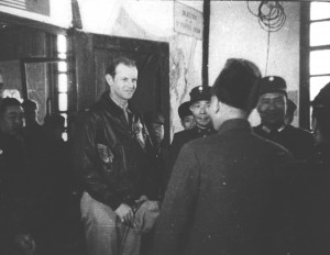 "Tex Hill greets Generalissimo Chiang Kai-shek, arriving at Hengyang to give the brand-new 23rd Fighter Group a ""pep talk."""