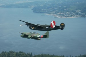A rare peaceful formation of an Me 262 Stormbird and a B-24 Liberator fly over a Washington ferry and the town of Mukilteo.