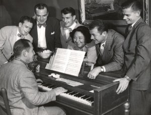 "Pancho Barnes was a talented composer of tunes like ""Song of the Air Force."" Here she tries out a new song with friends including Chuck Yeager (to her right), at the Happy Bottom Riding Club."