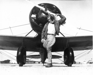 "Pancho Barnes poses with her Travel Air Model R ""Mystery Ship,"" which broke Amelia Earheart's speed record by hitting nearly 200 mph at Van Nuys Airport. Barnes paid over $13,000 for the plane, which was one of the fastest of its day."