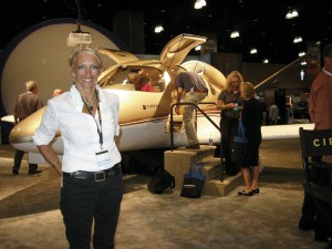 Patty Wagstaff, in front of Cirrus' personal jet, signed autographed photos in the Cirrus booth.