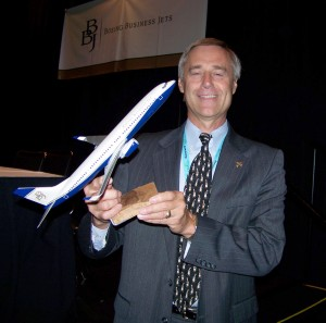 Steven Hill, Boeing Business Jets president, holds a scale model of one of the many Boeing Business Jets. They now include the original BBJ, BBJ 2, BBJ 3, B747-8 VIP and the B787-8 Dreamliner.