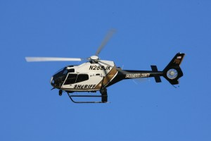 A Sacramento County Sheriff's Department Eurocopter EC 120 and crew make a final approach to the static display area.