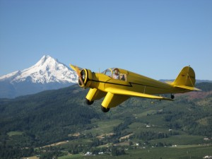 The Western Antique Aeroplane & Automobile Museum's collection of flying relics includes this rare 1937 Aeronca LC, passing by Oregon's Mount Hood.