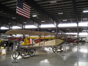 """Nestled among antique planes, vintage trucks and a Henderson motorcycle is this rare Curtiss JND-4 """"Jenny."""""""
