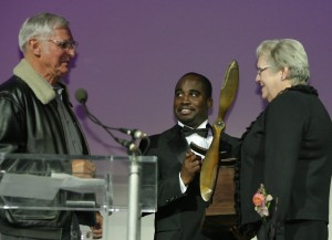 Dick Rutan (left) and Barrington Irving present Peggy Fossett (right) with the Spreading Wings award.