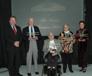"L to R: Mike Burrill poses with Brig. Gen. Staryl C. Austin Jr., Col. James Church, the wife of Col. Lawrence E. Campbell Jr. and the daughter of Nevilles E. ""Jim"" Walker. Wright Flyer trophies were presented to Oregon Aviation Hall of Honor recipients."