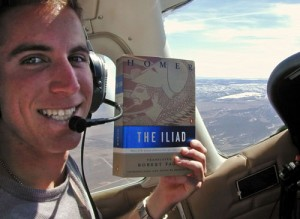 "Austin poses for extra credit with Homer's ""The Iliad"" over snow-covered terrain along the Utah-Colorado border."