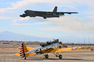 In an amazing contrast of our past and present, a B-52 takes off as Denny Don taxies by in his 1942 Ryan PT-22.