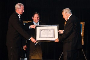 Museum board member Fred George (left) and president and CEO Jim Kidrick (center) present the induction certificate to Walter Zable, founder and CEO of Cubic Corporation.