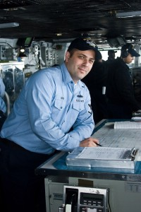 Quartermaster 3rd Class Lawrence Orso stands guard on the bridge of the USS Ronald Reagan. The quartermaster of the watch is responsible for the day-to-day navigation duties.