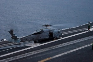 An SH-60F Seahawk helicopter of Helicopter Anti-Submarine Squadron 4 (HS-4), the Black Knights, prepares to launch prior to night flight operations.