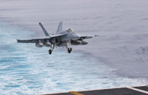 An F/A-18E Super Hornet refueler of Strike Fighter Squadron 115 (VFA-115), the Eagles, makes its landing approach to the flight deck during day operations.