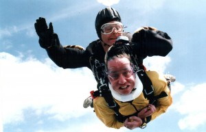 A victim of Lou Gehrig's disease, Jack Hughes can't walk or talk but he sky dives. Hughes, bottom, is in a tandem jump with his instructor, Pete Fiddler. His story is just one of dozens of inspirational tales in the book.