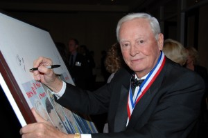 Barron Hilton signs the art board during the 5th annual Living Legends of Aviation.