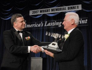 Jonathan Gaffney, National Aeronautics Association president, presents the Wright Brothers Memorial Trophy to Capt. Eugene A. Cernan.