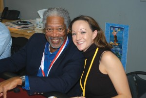 Morgan Freeman gives Linsey Lips some tips during a card game at the 3rd annual Living Legends of Aviation at Airport Journals offices.
