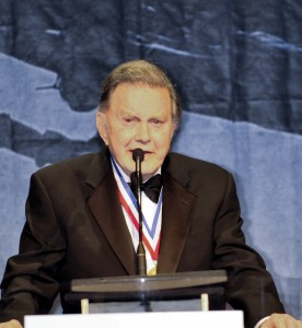 Cliff Robertson presents the Ambassador of Aviation Award during the 5th annual Living Legends of Avitation award ceremony.
