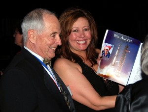 Bill Anders and Di Freeze sign a copy of Living Legends of Aviation during the 5th annual Living Legends of Aviation award ceremony.