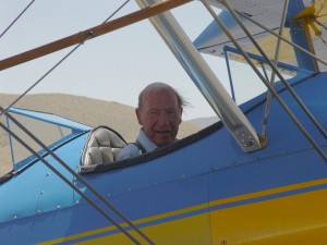 John Myers returns from a flight in Barron Hilton's Bull Stearman, during a beautiful summer weekend in 2003. On that particular weekend, Myers arrived at the Flying M Ranch in Clay Lacy's Lear 24.