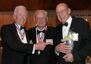 "Gene Cernan, Barron Hilton and John Myers enjoy time together during the 2006 Living Legends of Aviation award ceremony. Hilton described Myers as a ""legend of legends"" and ""one of the great pilots of all time."""