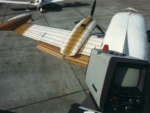 For the Robertson STOL Cessna 421, 100% chord Fowler flaps were uniquely designed & manufactured using composites. The flaps were tested for stall patterns using tufts for flow visualization. Note the period video camera 1971 mounted on the vertical tail.