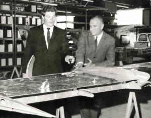 Reims Aviation President Pierre Closterman (right) and Robertson Aircraft Corporation President James Raisbeck review details of the Robertson STOL system being installed on the Reims Aviation Cessna 337 Milirole production line in France in 1970.