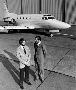 "James Raisbeck (left), with Kim Frinell, vice president of flight test and engineering, used this prototype Sabreliner to develop the Mark 5 supercritical wing in the 1970s. The ""hairs"" on the airplane—tufts of yarn—are for in-flight flow visualization."