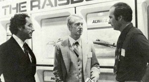 During NBAA 1977, Raisbeck employees Joe Clark (left) and Tom Wright (future chief test pilot on the Raisbeck 737 Stage 3 program) converse with Procter & Gamble's director of aviation (center). The company bought 4 retrofit systems for its Sabreliner 80s