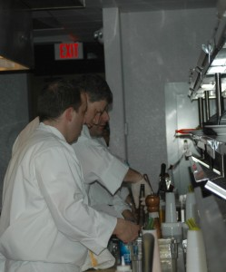 Executive Chef Peter DeVito (foreground) oversees the preparation of in-flight meals. DeVito graduated from the Culinary Institute of America in 1997, and worked in upscale restaurants in New York City, Connecticut and California.
