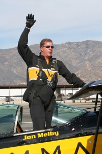 Jon Melby waves to the crowd after his exciting aerobatics demonstration.