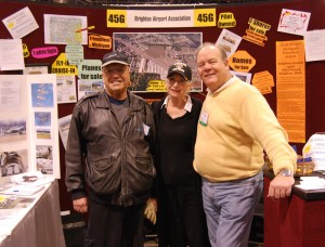 L to R: Morrey Wyman, Gail Wyman and Jim Zantop pose in front of the Brighton Airport Association booth.