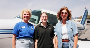 Pilots Ceci Stratford (left) and Ruth Logan flank Young Eagle Erin Thorpe. Thorpe now holds commercial and multi-engine ratings and received a full Navy scholarship to Purdue.