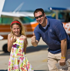 New Young Eagle Caitlin Rowe and pilot Chris Hibben both give her experience thumbs up at the end of Rowe's first flight. She was part of the one million young people to fly in the Young Eagles by December 2003.