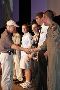 EAA President Tom Poberezny (left) shakes hands with David Marten, a B-1B instructor pilot and former Young Eagle.