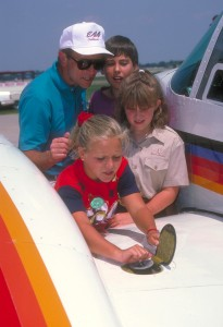 Tom Poberezny keeps a watchful eye on some soon-to-be Young Eagles as they pre-flight the airplane in this 1992 photo.