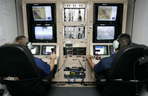 Pilots of U.S. Customs and Border Protection fly UAVs from a control room that may be placed off the airport.