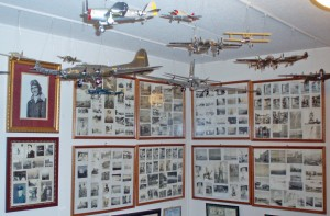 Model planes and historic photos, including Art Unruh in World War II flying gear, are prominently displayed in Unruh's office.