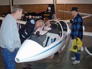 Gliders displayed by NorthWest Eagle Soaring from Arlington Airport attracted crowds fascinated by the giant wingspan and high-tech instrument panel of the DG-1000, flown by William Lynn Weller, owner of the business.