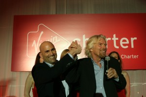 "Richard Branson, clasping the hand of Scott Duffy, Virgin Charter CEO and founder, said Virgin's ""brilliant customer service and aviation expertise combined with unprecedented technology prowess has resulted in a winning formula."""