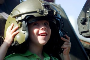 The book includes photos of many people, including performers like Sean Tucker and Patty Wagstaff and air show attendees like this delighted child.