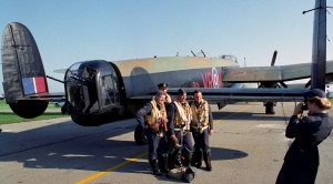 Air show re-enactors play a major role at the show. Here they pose for pictures alongside a British Avro 683X Lancaster owned by the Canadian Warplane Heritage Museum in Mount Hope, Ontario.