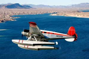 The Twin Beech breaks over Lake Mohave for a water landing.